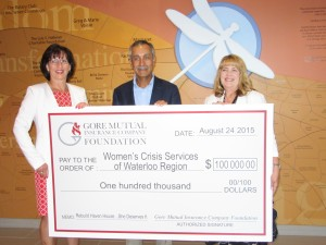 Heidi Sevcik, President and CEO of Gore Mutual and Farouk Ahamed, Chair of the Board of Gore Mutual, presented a donation to Mary Zilney, CEO of Women's Crisis Services.